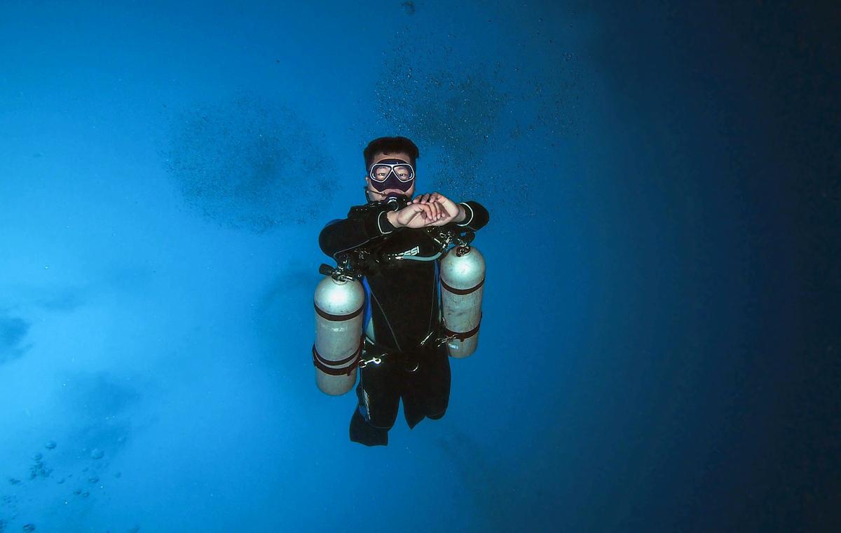 Sidemount diver from below