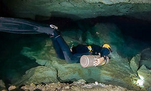 Sidemount diver in a cave