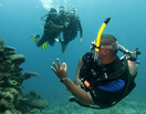 PADI Divemaster supervising certified divers.