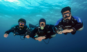 Three sidemount divers