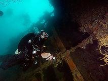 Diver at a wreck entrance
