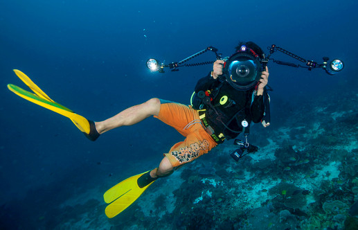 Scuba diver with an underwater camera.