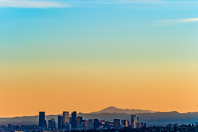 Denver skyline and mountains view at sun