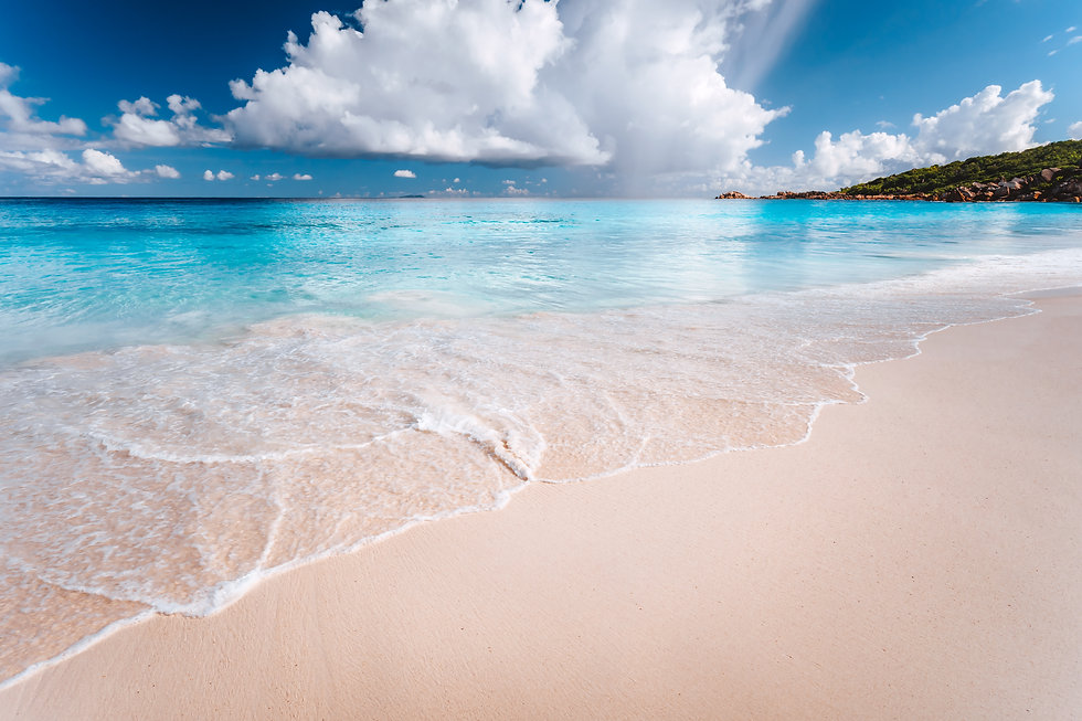 white-clouds-above-blue-ocean-lagoon-wit