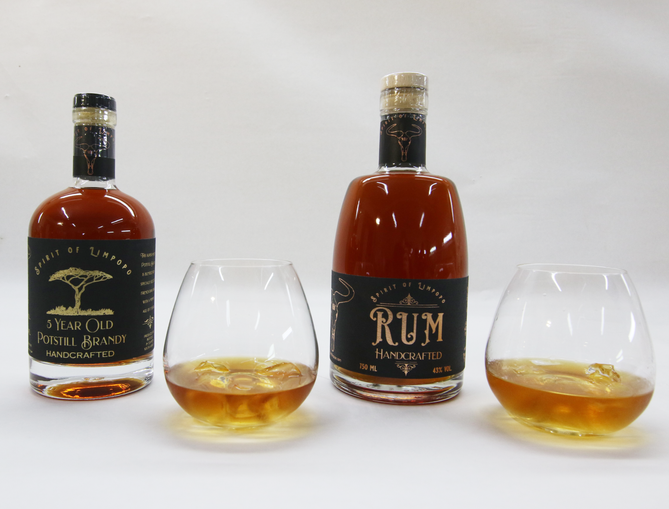 Rum & Brandy Bottle and glasses.png