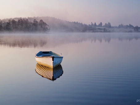 Boats and misty dawn in the Trossachs