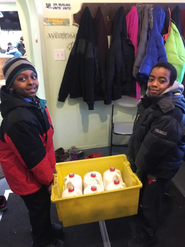 Here we have two African refugees helping our team unload and distribute food for our donation to refugee families recently settled in Chicago. The event was a partnership with Islamic Oasis.