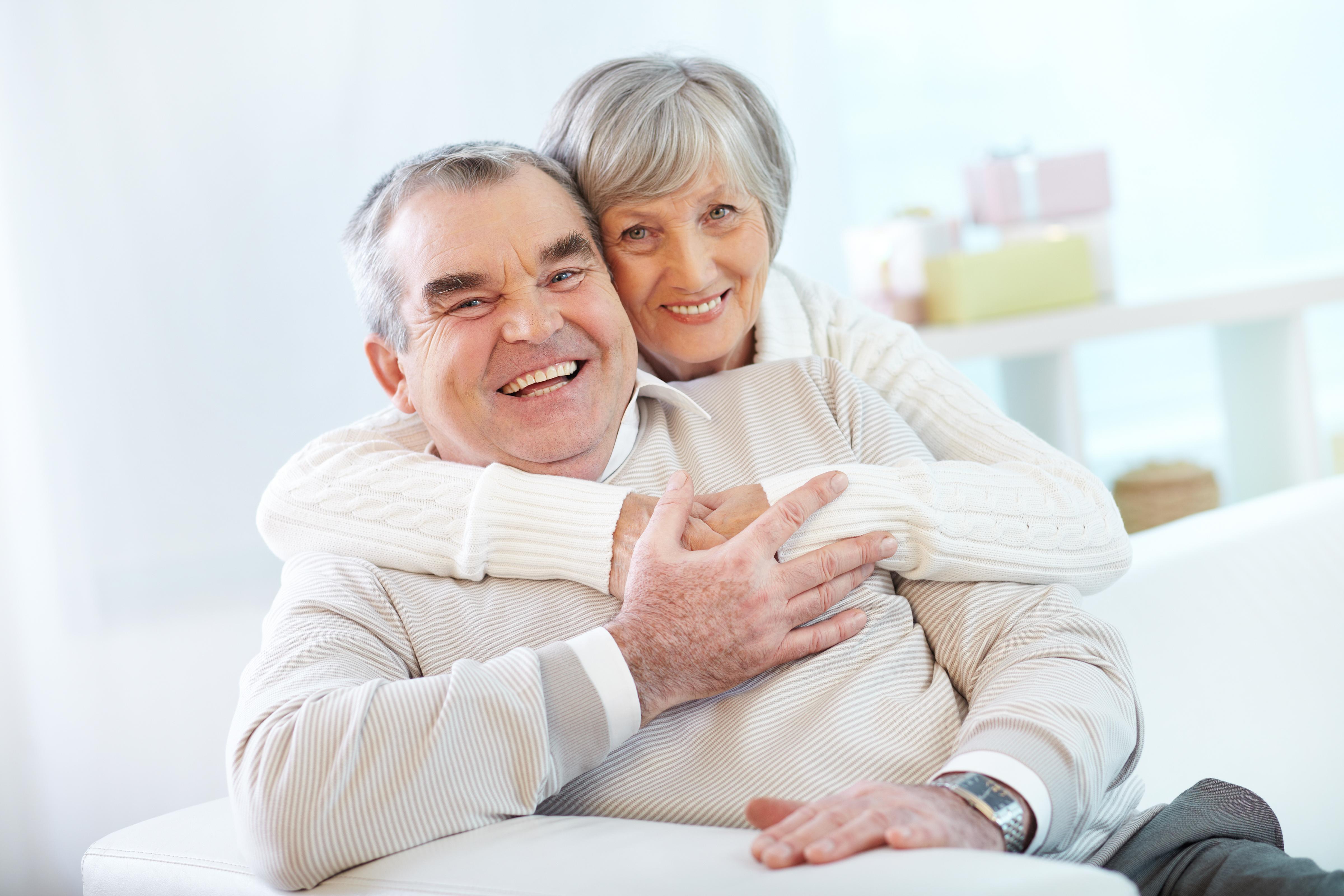 senior-couple-hugging-home