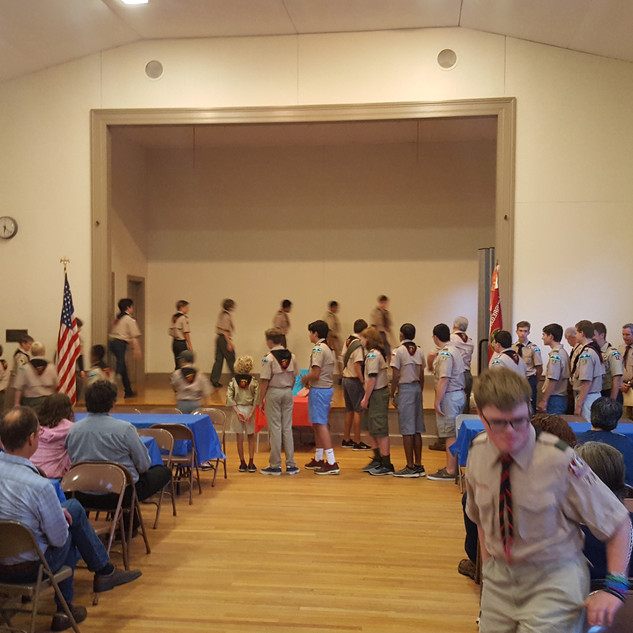 Scouts forming on stage