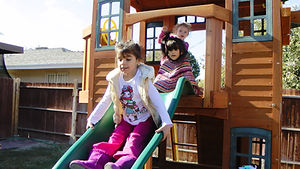 Girls playing on the slide