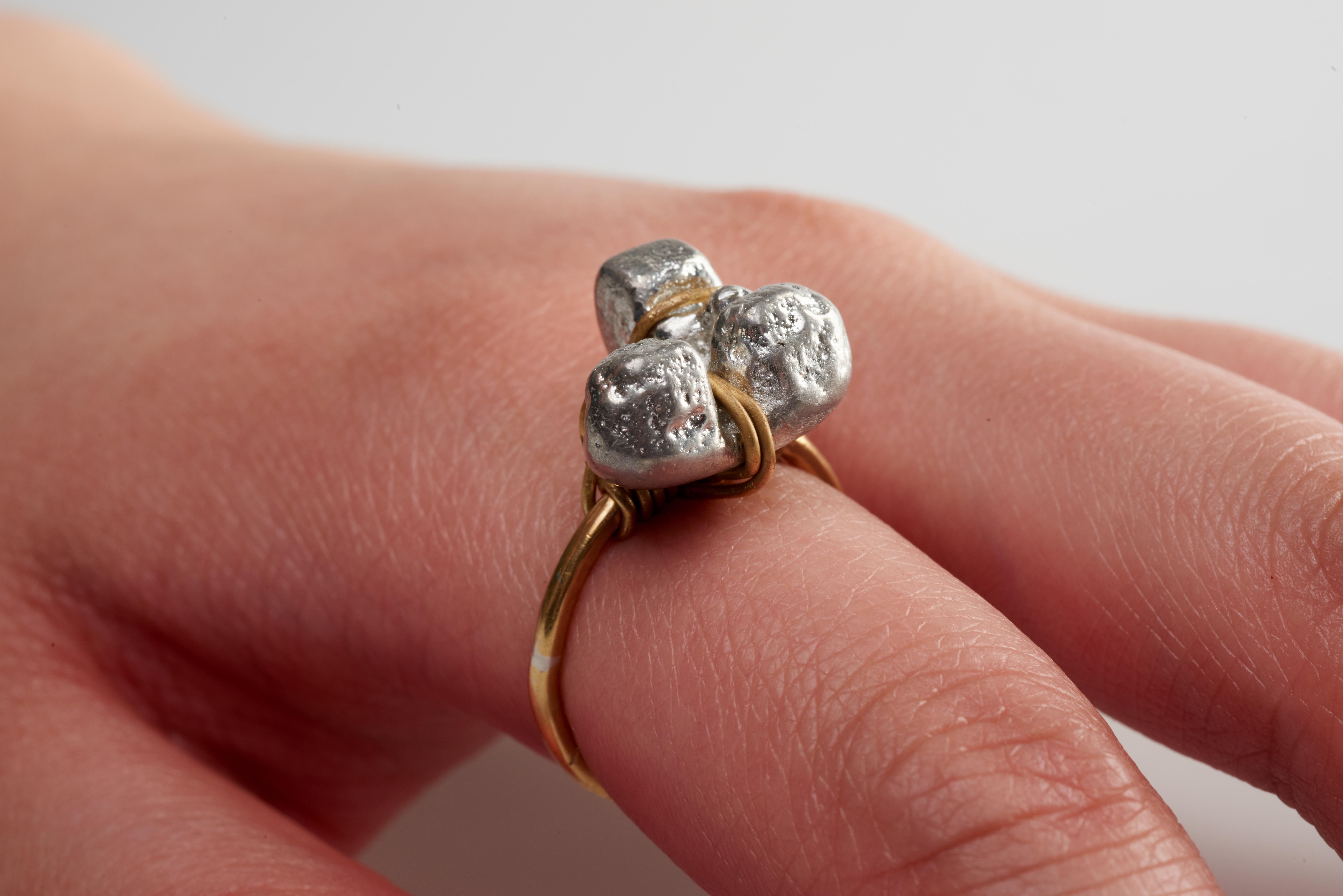 ring- brass, pewter. (2)