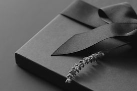 Black gift box on a dark background, dec