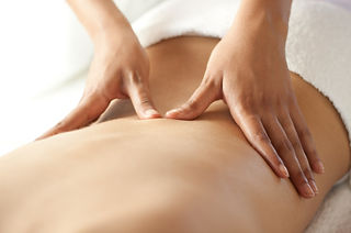 Person getting massage treatment in Fredericton