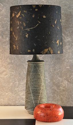 Handmade tall ceramic lamp with handmade paper shade.
