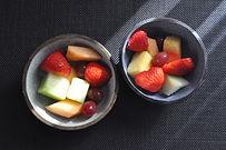 Small black ceramic bowls with blue speckled interiors, contemporary design.