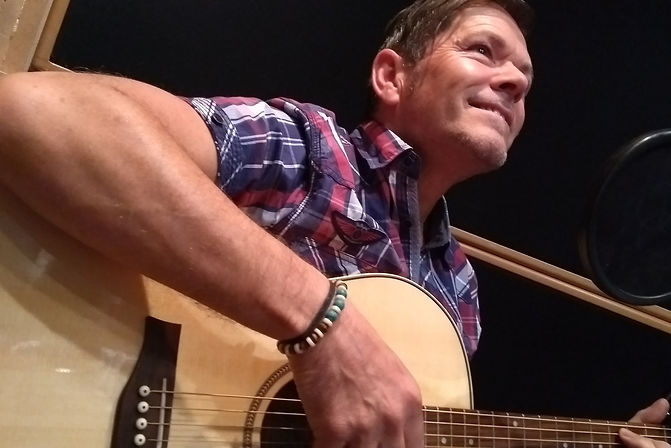 Islander Folk Singer Songwriter Guitarist