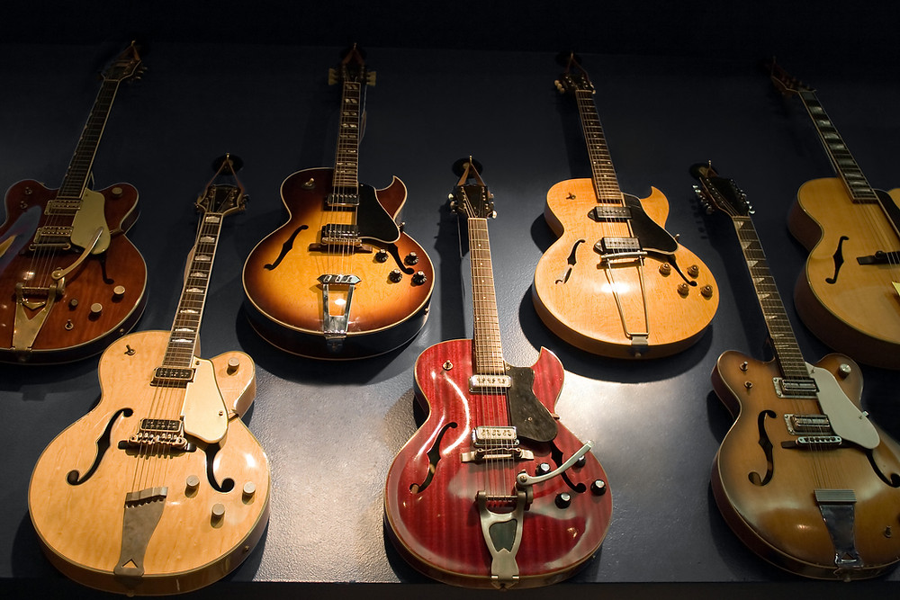 a picture of guitars hanging on the wall