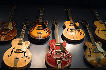 guitars on a wall for guitar classes