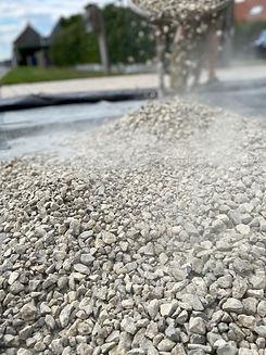 man-dumping-gravel-stones-on-the-ground-