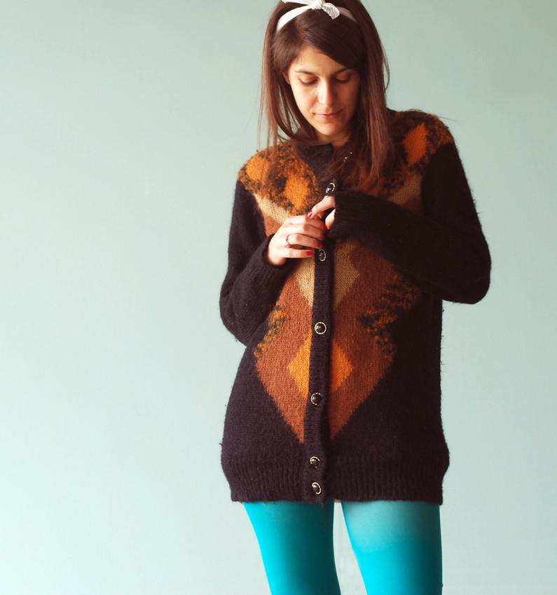 Woman wearing brown sweater