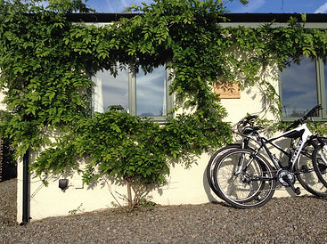 Mountain bikes resting on the cottage wall