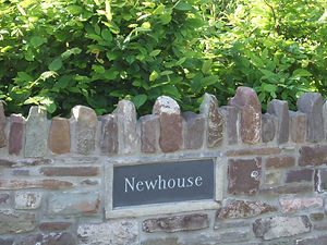 """Newhouse"" name on stone wall at entrance drive to Crab Apple Cottage"