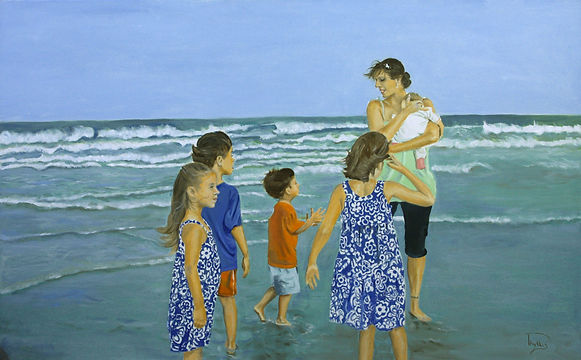 Young family spending a day at the beach.