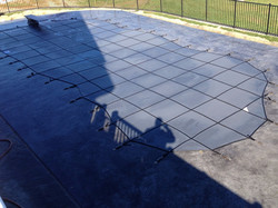 In-ground swimming pool safety cover