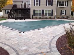 Inground swimming pool safety cover