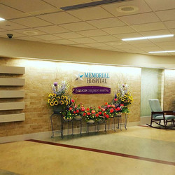I got to create arrangement to highlight the new Memorial Children's Hospital sign in the main lobby