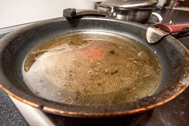 never pour grease down your sink, don't pour grease down your kitchen sink, how to dispose of grease, grease disposal, grease down the the kitchen sink