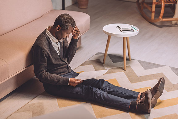 frustrated man on the floor, signs your pipes may be breaking, signs of broken pipes, signs of leaky pipes, indicators of pipe leak, need to repair your pipes