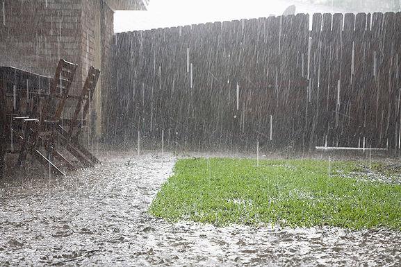 heavy rain in backyard, how rain affects plumbing, how storms affect plumbing, weather and plumbing, rain damage to house, property damage from rain