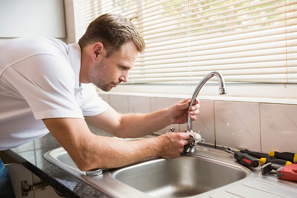 plumber fixing leaky tap, avoiding a Halloween plumbing scare, Halloween plumbing disaster, Halloween garbage disposal clogs, tips to avoid a Halloween plumbing scare, prevent Halloween plumbing disasters