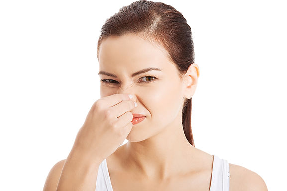 woman holding nose, never pour grease down your sink, don't pour grease down your kitchen sink, how to dispose of grease, grease disposal, grease down the the kitchen sink