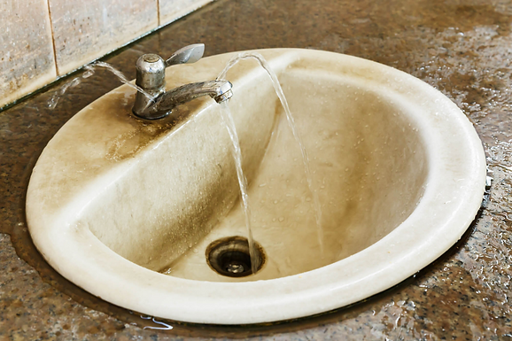 leaky and moldy tap, avoiding a Halloween plumbing scare, Halloween plumbing disaster, Halloween garbage disposal clogs, tips to avoid a Halloween plumbing scare, prevent Halloween plumbing disasters