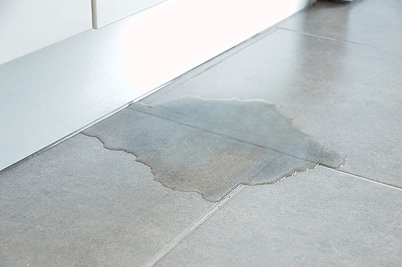 water spot on floor, signs your pipes may be breaking, signs of broken pipes, signs of leaky pipes, indicators of pipe leak, need to repair your pipes