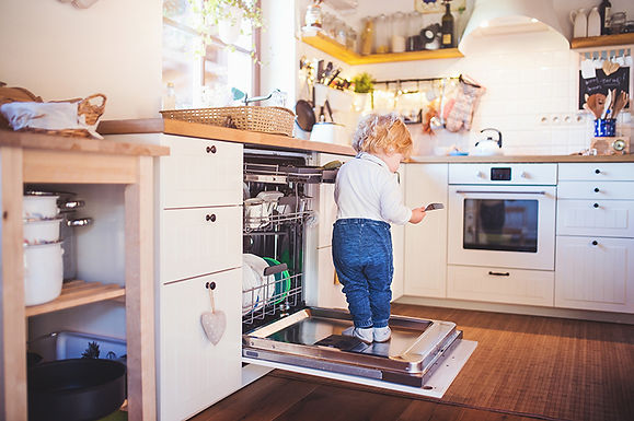 kid standing on dishwasher, dishwasher leaks and malfunctions, common dishwasher problems, causes of dishwasher leaks, how to fix my dishwasher