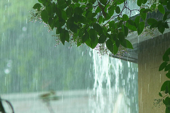 heavy rain from gutter, how rain affects plumbing, how storms affect plumbing, weather and plumbing, rain damage to house, property damage from rain