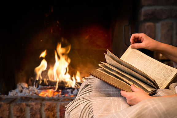 reading by the fireplace, DIY home insulation tips, how to insulate windows, how to keep the cold out, how to insulate my house, simple home insulation tips, home insulation tips for winter