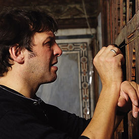 Conservator at work on an ARCHiNOS conservation project