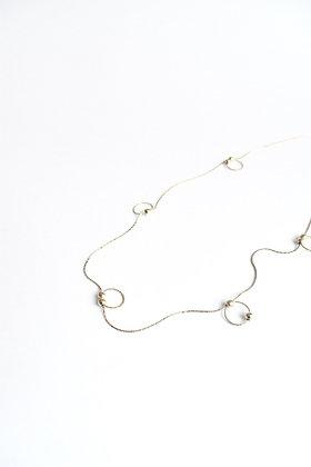 Circus - Sautoir - Cinq boucles et neuf perles de métal