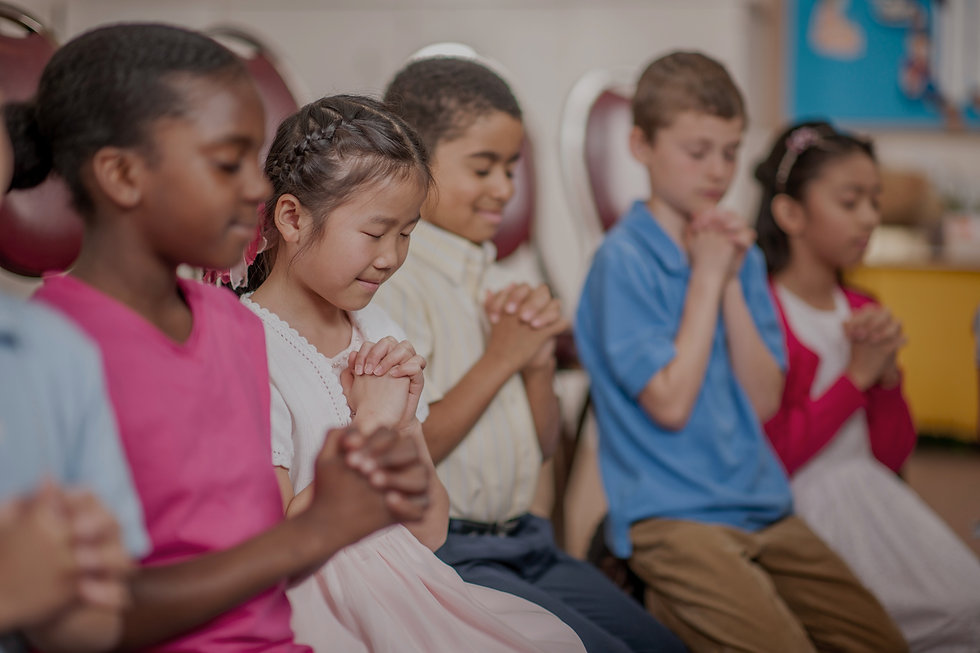 Photo of children praying.