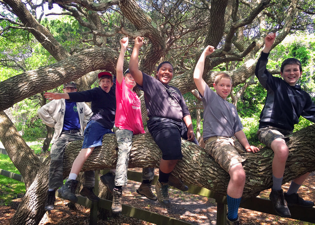 Camp Cameron boys cheering on tree