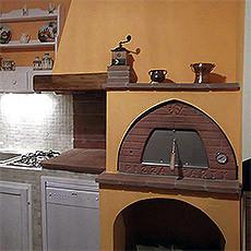 horno de leña en la cocina.jpg