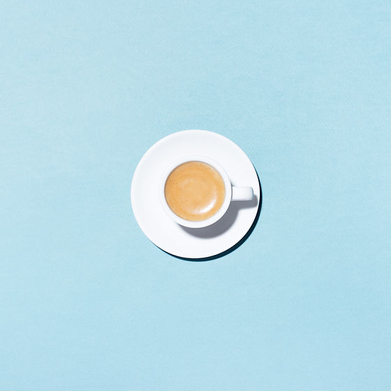 a-cup-of-coffee-on-blue-background-28QZG