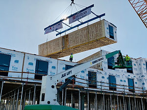 Proset Construction, Inc. modular set boxes construction site crane