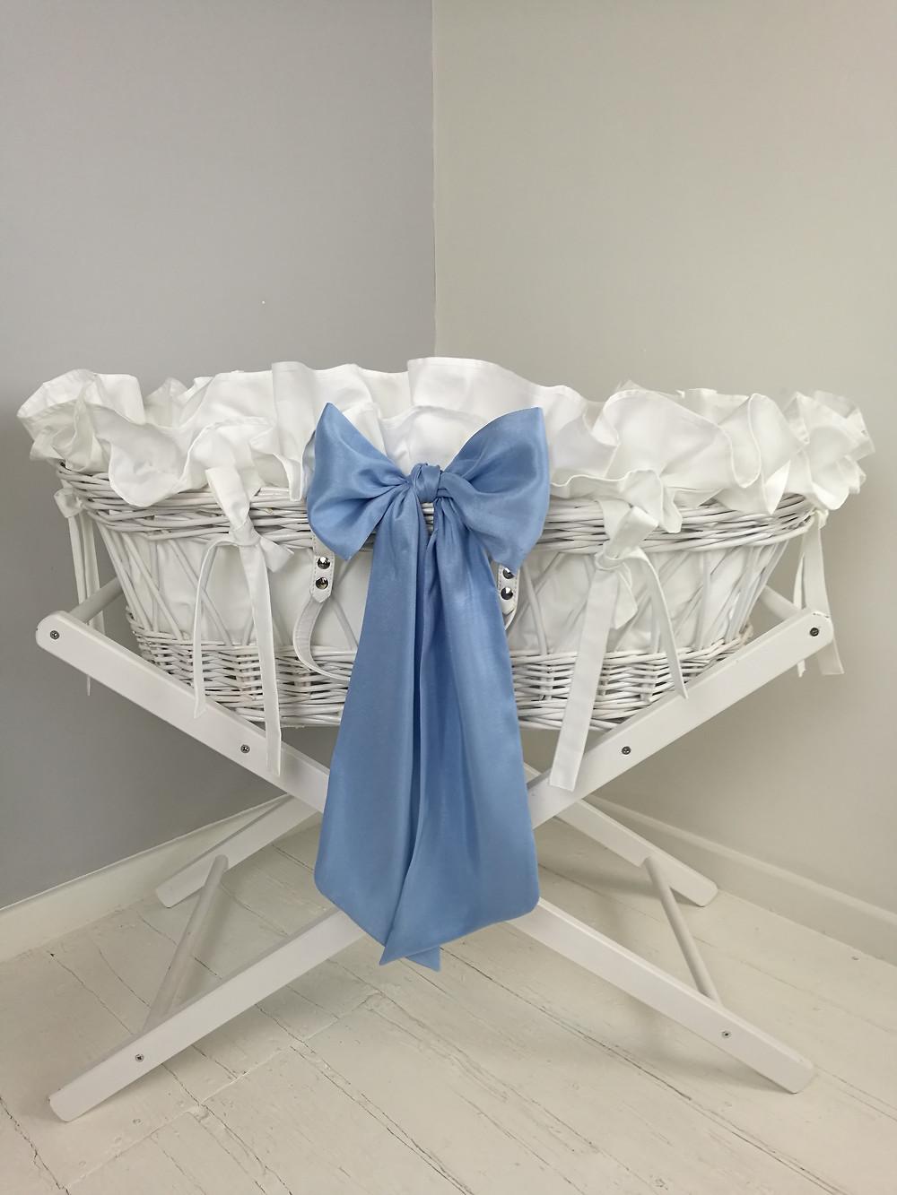 Baby boy's Moses basket blue silk bows