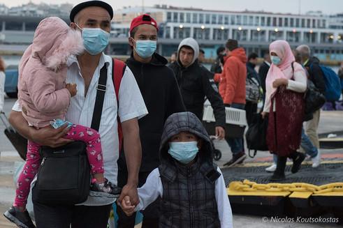 Asylum seekers arrive at the Port of Piraeus as coronavirus lockdown is lifted