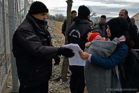 Refugees cross the Greek - FYROM border